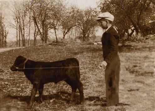 J.L. Hoskins, and his calf